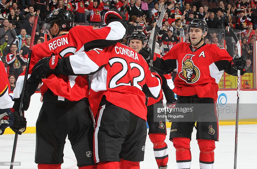 Chris Phillips #4 of the Ottawa Senators celebrates a goal against the Florida Panthers with teammates <a gi-track='captionPersonalityLinkClicked' href=/galleries/search?phrase=Peter+Regin&family=editorial&specificpeople=690589 ng-click='$event.stopPropagation()'>Peter Regin</a> #13, Erik Condra #22 and <a gi-track='captionPersonalityLinkClicked' href=/galleries/search?phrase=Sergei+Gonchar&family=editorial&specificpeople=202470 ng-click='$event.stopPropagation()'>Sergei Gonchar</a> #55 on January 21, 2013 at Scotiabank Place in Ottawa, Ontario, Canada.