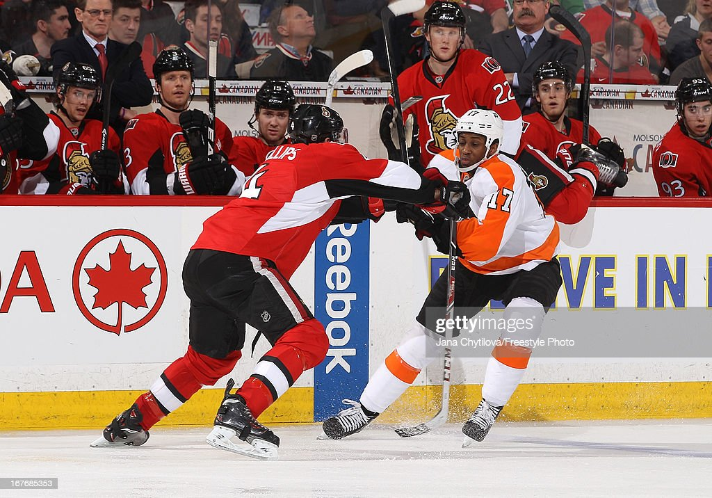 Chris Phillips #4 of the Ottawa Senators defends against <a gi-track='captionPersonalityLinkClicked' href=/galleries/search?phrase=Wayne+Simmonds&family=editorial&specificpeople=4212617 ng-click='$event.stopPropagation()'>Wayne Simmonds</a> #17 of the Philadelphia Flyers during an NHL game, at Scotiabank Place, on April 27, 2013 in Ottawa, Ontario, Canada.