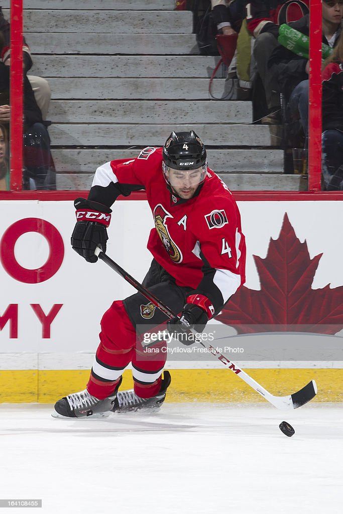 Chris Phillips #4 of the Ottawa Senators skates with the puck during an NHL game against the Winnipeg Jets at Scotiabank Place on March 17, 2013 in Ottawa, Ontario, Canada.