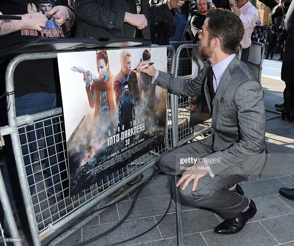 Chris Pine signs a poster at the UK Premiere of 'Star Trek Into Darkness' at The Empire Cinema on May 2, 2013 in London, England.