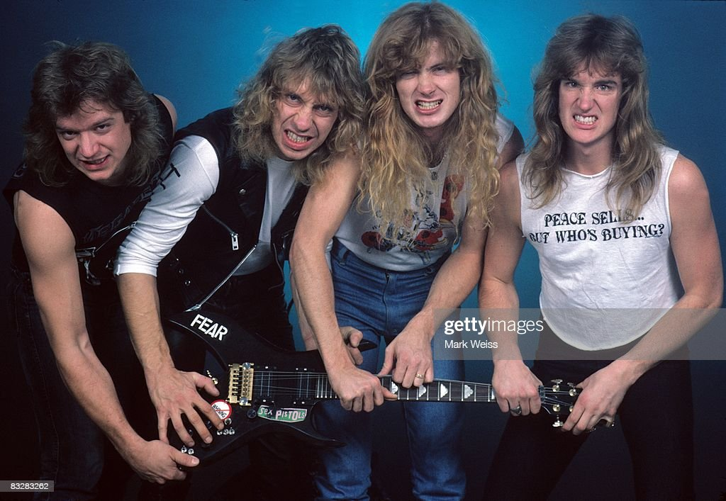 Chris Poland Gar Samuelson Dave Mustaine and David Ellefson of the heavy metal band 'Megadeth' pose for a portrait holding a guitar in 1986 in New...