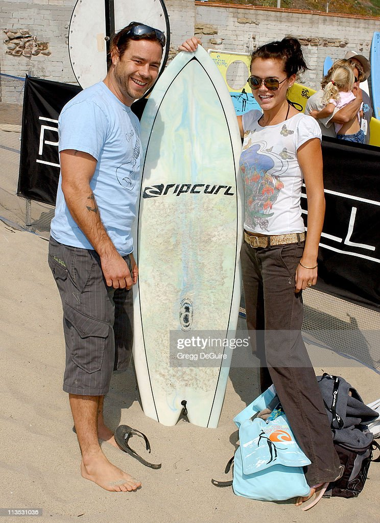 Chris Pontius and wife Claire during The Rip Curl Malibu Pro Hosts 'Celebrity Surf 'Bout' Arrivals at Malibu Surfrider Beach in Malibu California...