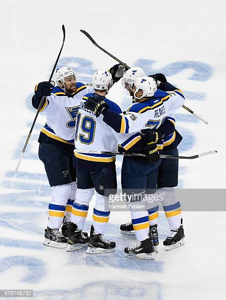 Chris Porter Jay Bouwmeester Alex Pietrangelo and Ryan Reaves of the St Louis Blues celebrate a goal against the Minnesota Wild by Reaves during the...