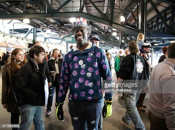 Chris Porter of Seattle arrives at a rally for Democratic presidential candidate Bernie Sanders at Safeco Field in Seattle on March 25 2016 / AFP /...