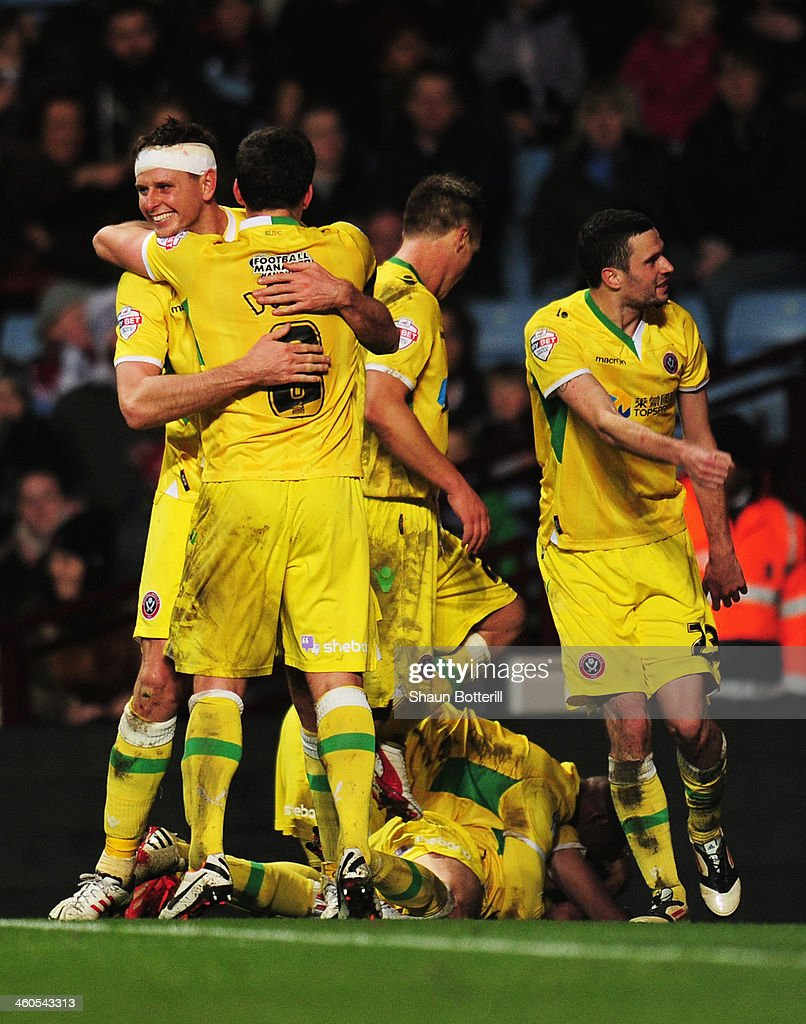 Chris Porter (wearing bandage) of Sheffield United celebrates the goal scored by Ryan Flynn with team mates during the Budweiser FA Cup third round match between Aston Villa and Sheffield United at Villa Park on January 4, 2014 in Birmingham, England.