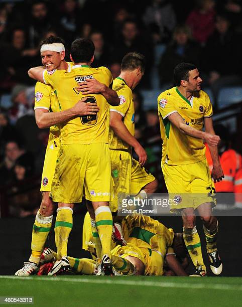 Chris Porter of Sheffield United celebrates the goal scored by Ryan Flynn with team mates during the Budweiser FA Cup third round match between Aston...