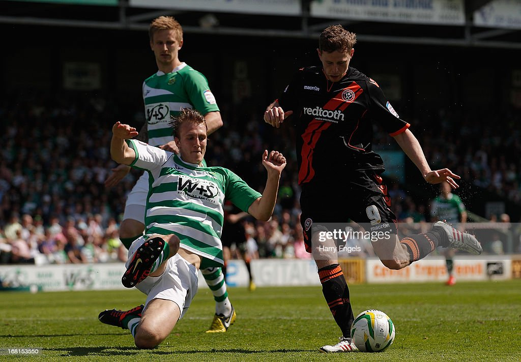 Chris Porter of Sheffield United (R) has his shot blocked by Daniel Burn of Yeovil Town during the npower League One Play Off Semi Final second leg match between Yeovil Town and Sheffield United at Huish Park on May 6, 2013 in Yeovil, England.