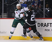 Chris Porter of the Minnesota Wild and Marek Zidlicky of the New York Islanders collide along the boards during the first period at the Barclays...