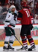 Chris Porter of the Minnesota Wild and Martin Hanzal of the Arizona Coyotes during the NHL game at Gila River Arena on October 15 2015 in Glendale...