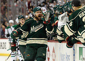 Chris Porter of the Minnesota Wild celebrates scoring a goal against the Dallas Stars during the first period of Game Three of the Western Conference...