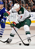Chris Porter of the Minnesota Wild controls the puck against the Toronto Maple Leafs during game action on March 3 2016 at Air Canada Centre in...