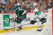 Chris Porter of the Minnesota Wild controls the puck with Johnny Oduya of the Dallas Stars defending in Game Three of the Western Conference...
