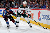 Chris Porter of the Minnesota Wild controos the puck against Matt Duchene of the Colorado Avalanche at Pepsi Center on October 8 2015 in Denver...