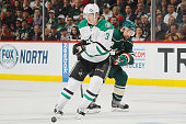 Chris Porter of the Minnesota Wild defends John Klingberg of the Dallas Stars in Game Four of the Western Conference First Round during the 2016 NHL...
