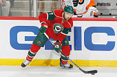 Chris Porter of the Minnesota Wild handles the puck against the Philadelphia Flyers during the game on January 7 2016 at the Xcel Energy Center in St...