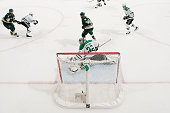 Chris Porter of the Minnesota Wild scores a goal against Kari Lehtonen of the Dallas Stars in Game Three of the Western Conference First Round during...