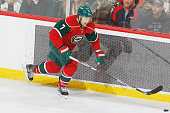 Chris Porter of the Minnesota Wild skates to the puck against the Detroit Red Wings during the game on December 28 2015 at the Xcel Energy Center in...