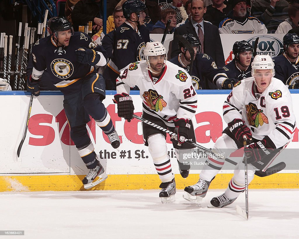 Chris Porter #32 of the St. Louis Blues comes over the boards as <a gi-track='captionPersonalityLinkClicked' href=/galleries/search?phrase=Johnny+Oduya&family=editorial&specificpeople=3944055 ng-click='$event.stopPropagation()'>Johnny Oduya</a> #27 and <a gi-track='captionPersonalityLinkClicked' href=/galleries/search?phrase=Jonathan+Toews&family=editorial&specificpeople=537799 ng-click='$event.stopPropagation()'>Jonathan Toews</a> #19 skate in an NHL game on February 28, 2013 at Scottrade Center in St. Louis, Missouri.