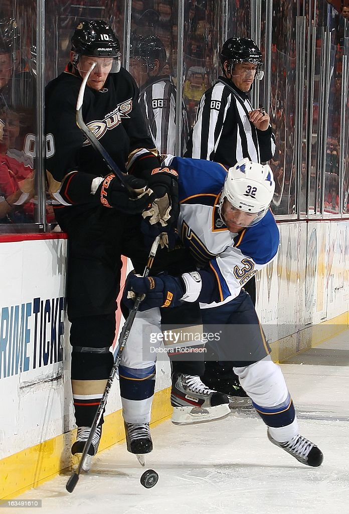 Chris Porter #32 of the St. Louis Blues digs for the puck off the boards against <a gi-track='captionPersonalityLinkClicked' href=/galleries/search?phrase=Corey+Perry&family=editorial&specificpeople=213864 ng-click='$event.stopPropagation()'>Corey Perry</a> #10 of the Anaheim Ducks on March 10, 2013 at Honda Center in Anaheim, California.