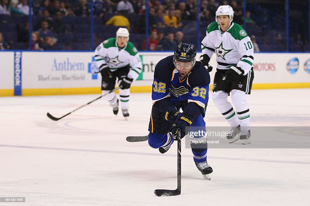 Chris Porter #32 of the St. Louis Blues skates up ice to control a loose puck during a preseason game against the Dallas Stars at the Scottrade Center on September 21, 2013 in St. Louis, Missouri.