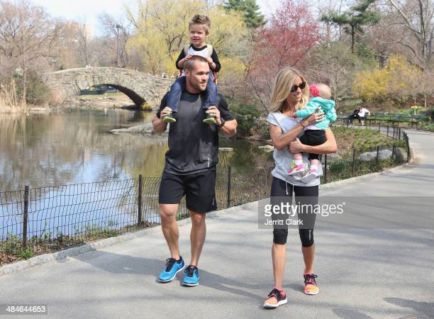 Chris Powell and wife Heidi Powell go for a family outing with son Cash and daughter Ruby at Central Park while in NYC for the Reebok Spartan Race on...