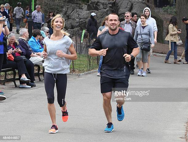 Chris Powell and wife Heidi Powell go for a run in Central Park while in NYC for the Reebok Spartan Race on April 13 2014 in New York City