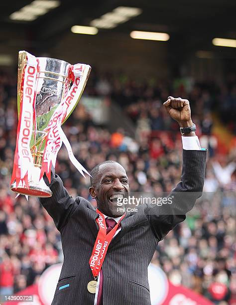 Chris Powell Manager of Charlton lifts the npower Trophy after winning the npower League One match between Charlton Athletic and Hartlepool United at...