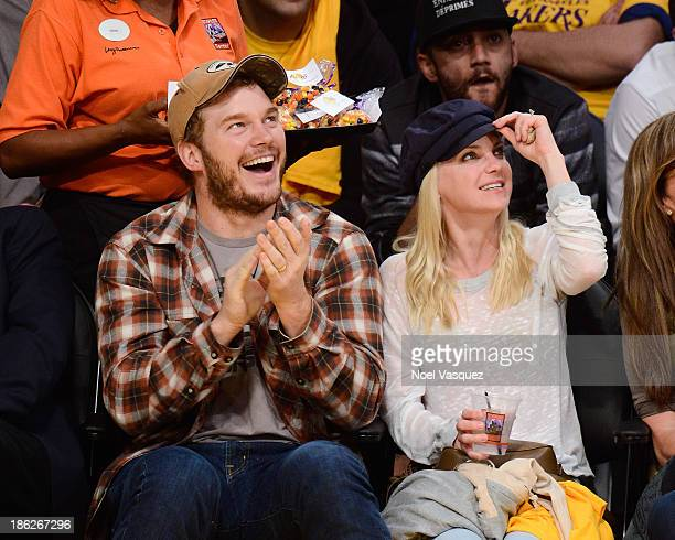 Chris Pratt and Anna Faris attend a basketball game between the Los Angeles Clippers and the Los Angeles Lakers at Staples Center on October 29 2013...