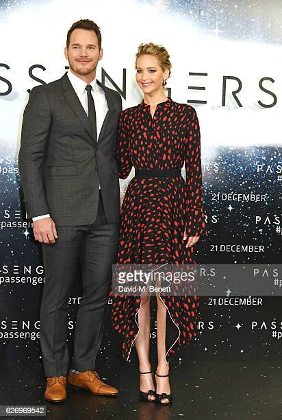 Chris Pratt and Jennifer Lawrence pose at a photocall for 'Passengers' at Claridge's Hotel on December 1 2016 in London England