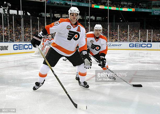 Chris Pronger and Blair Betts of the Philadelphia Flyers set up in the defensive zone against the Boston Bruins on January 1 2010 during the 2010...