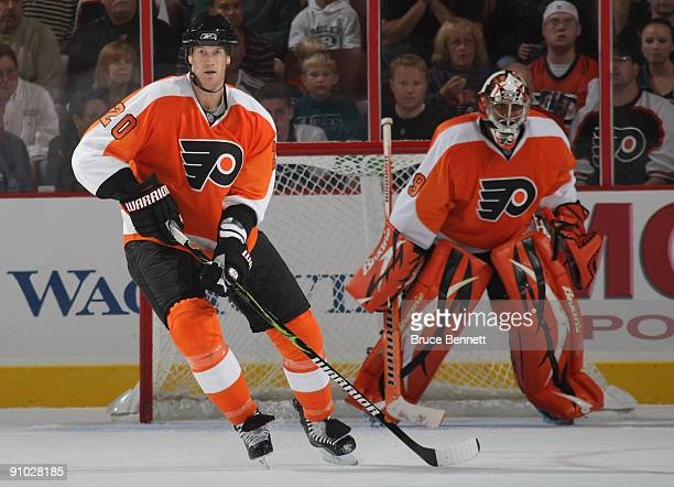 ... Chris Pronger and goaltender Ray Emery of the Philadelphia Flyers  defend their end of the ice ... e59da5b8b
