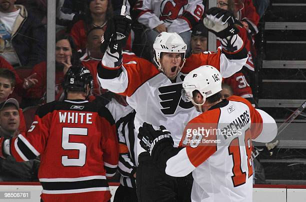Chris Pronger and Mike Richards of the Philadelphia Flyers celebrate a second period power play goal by Kimmo Timonen against the New Jersey Devils...