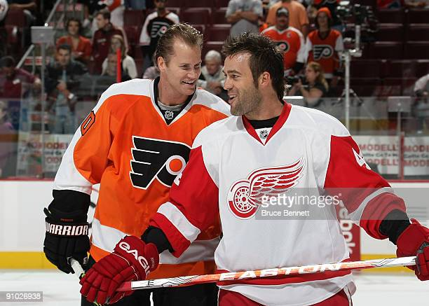 Chris Pronger of the Philadelphia Flyers and Todd Bertuzzi of the Detroit Red Wings skate in warmups prior to preseason action at the Wachovia Center...