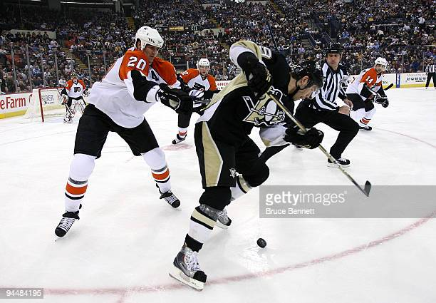 Chris Pronger of the Philadelphia Flyers hits Pascal Dupuis of the Pittsburgh Penguins at the Mellon Arena on December 15 2009 in Pittsburgh...