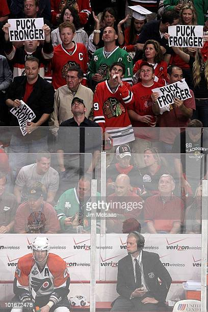 Chris Pronger of the Philadelphia Flyers sits on the bench beneath signs held by fans of the Chicago Blackhawks in Game Five of the 2010 NHL Stanley...
