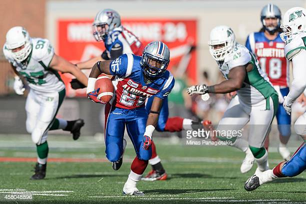 Chris Rainey of the Montreal Alouettes carries the ball during the CFL game against the Saskatchewan Roughriders at Percival Molson Stadium on...