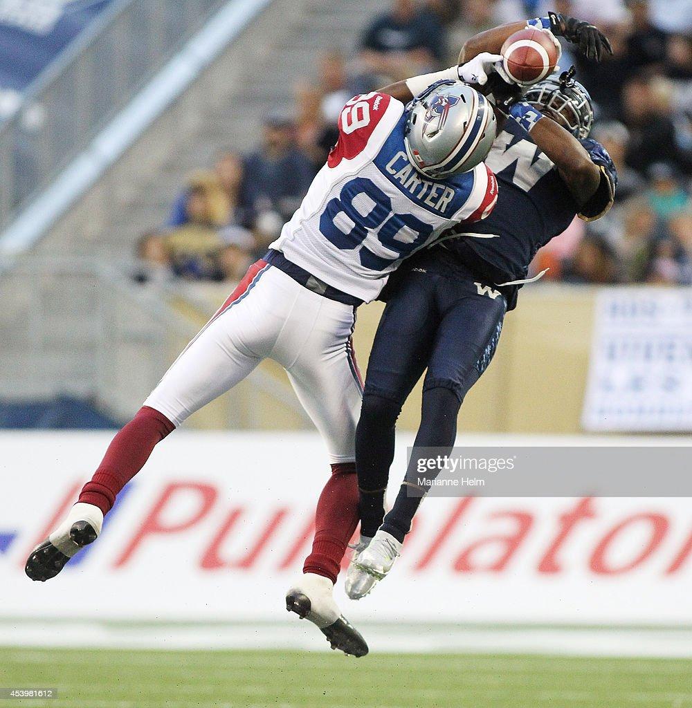 Chris Randle #8 of the Winnipeg Blue Bombers puts pressure on intended receiver Duron Carter #89 of the Montreal Alouettes in first quarter action in a CFL game at Investors Group Field on August 22, 2014 in Winnipeg, Manitoba, Canada.