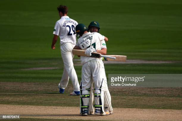 Chris Read of Nottinghamshire celebrates his century with team mate Billy Root during day three of the Specsavers County Championship Division Two...