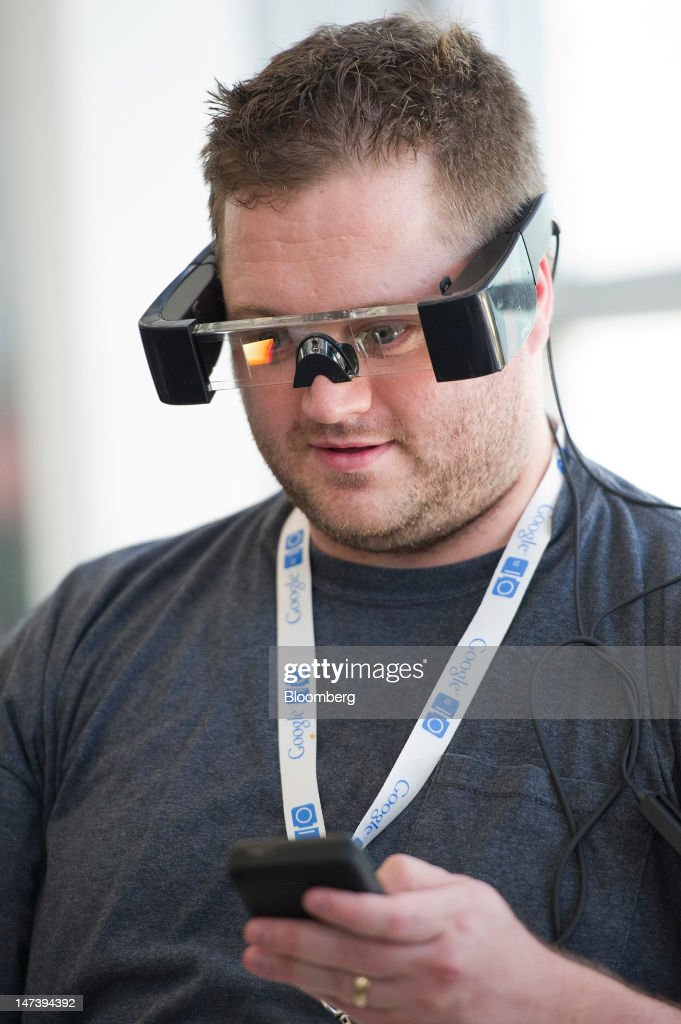 Chris Rebstock tries out the Moverio BT-100 see-through wearable display made by Seiko Epson Corp. during the Google I/O conference in San Francisco, California, U.S., on Thursday, June 28, 2012. Google Inc., owner of the world's most popular search engine, unveiled a cloud-computing service for building and running applications to help woo customers and challenge Amazon.com Inc.'s Web Services. Photographer: David Paul Morris/Bloomberg via Getty Images