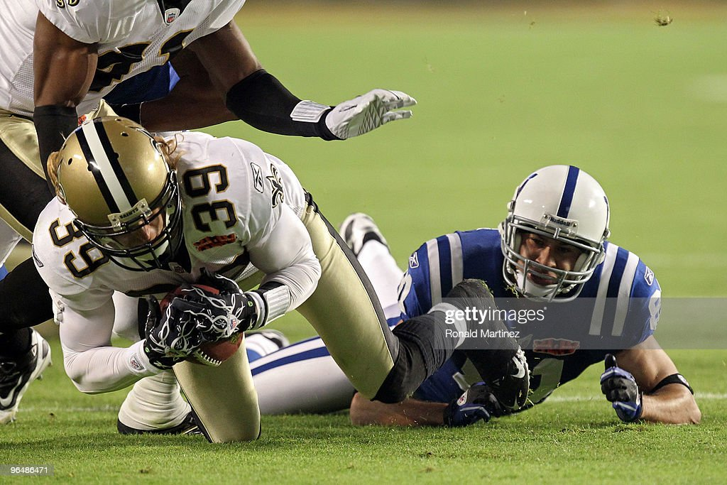 Chris Reis of the New Orleans Saints fight for the ball against Hank Baskett of the Indianapolis Colts after a onside kick to start the second half...