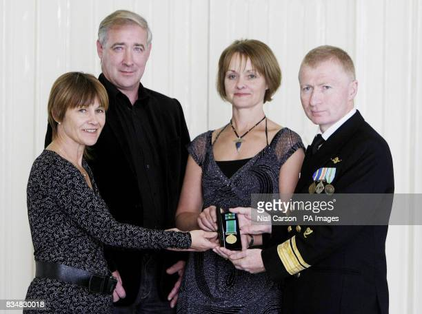 Chris Reynolds Director of the Irish Coastguard presents a posthumous gold medal for bravery to the family of Seamus Byrnes his sister Breeda his...