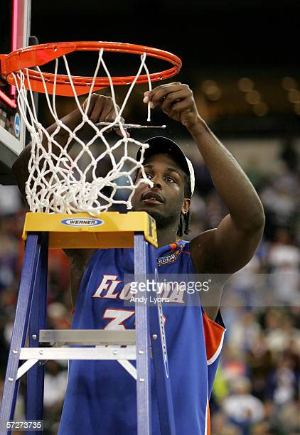 Chris Richard of the Florida Gators celebrates by cutting down the net after defeating the UCLA Bruins during the National Championship game of the...