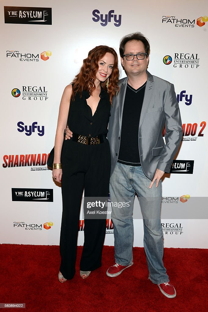 Chris Ridenhour and Eliza Swenson arrive to the premiere of Sharknado 2 The Second One held at the Regal Cinemas at LA Live Thursday evening