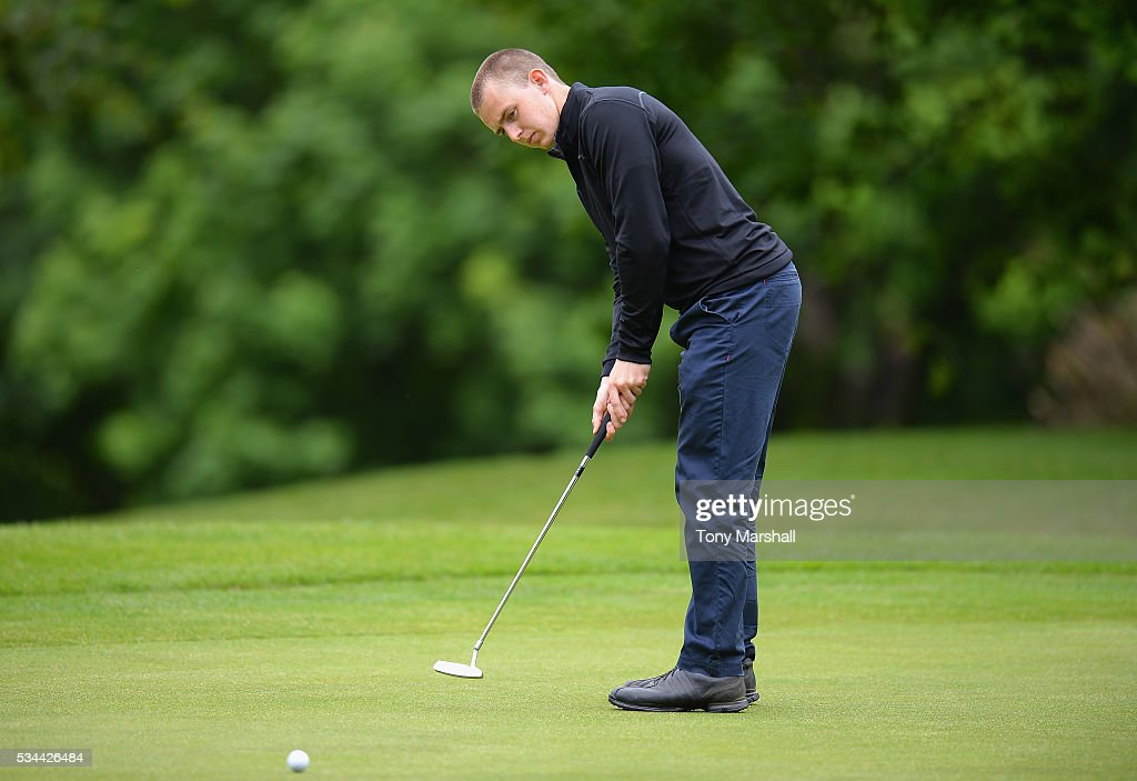 Chris Rippon of Mickleover Golf Club putts on the 18th green during the PGA Assistants Championships - Midlands Qualifier at the Coventry Golf Club on May 26, 2016 in Coventry, England.