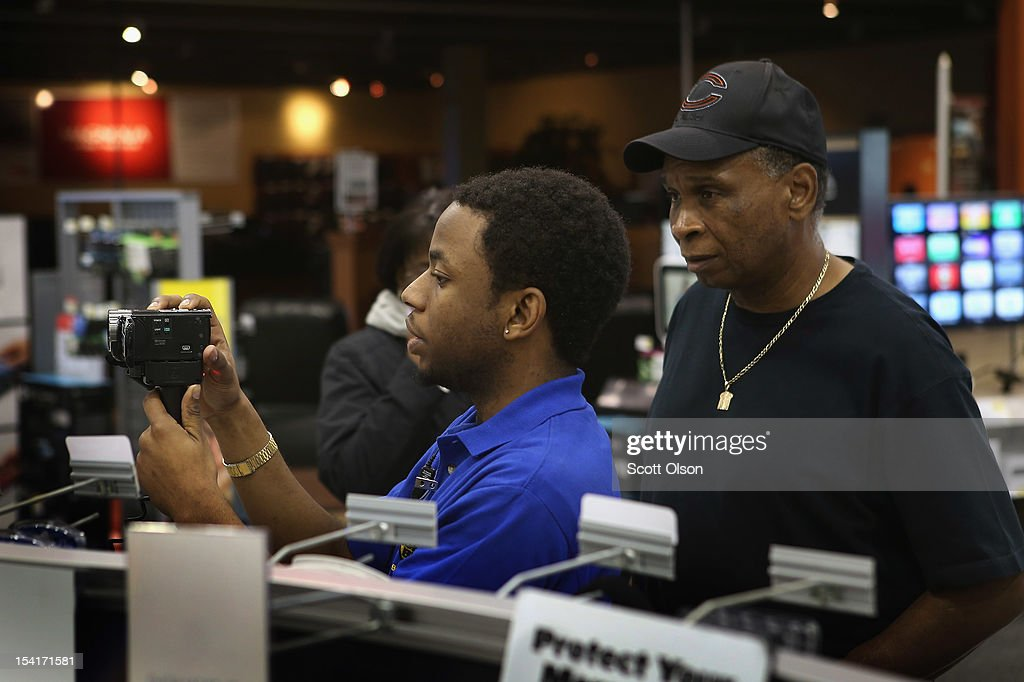 Chris Roberts (R) helps J. D. Massey shop for a video camera at a Best Buy store on October 15, 2012 in Chicago, Illinois. Retail sales rose 1.1 percent last month with electronics and appliances leading the way with a 4.5 percent increase in sales.