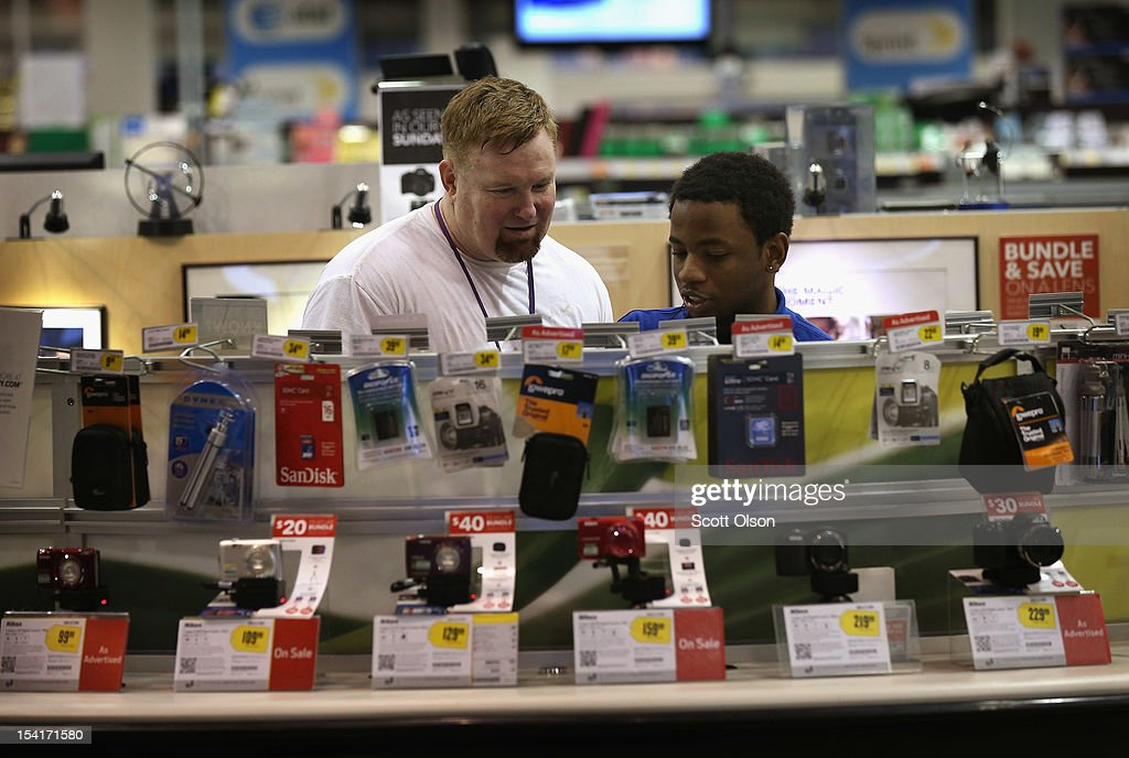 Chris Roberts (R) helps Pat McDonald shop for a camera at a Best Buy store on October 15, 2012 in Chicago, Illinois. Retail sales rose 1.1 percent last month with electronics and appliances leading the way with a 4.5 percent increase in sales.