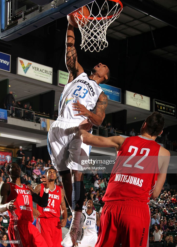 Chris Roberts #23 of the Texas Legends rises for a dunk against <a gi-track='captionPersonalityLinkClicked' href=/galleries/search?phrase=Donatas+Motiejunas&family=editorial&specificpeople=5561687 ng-click='$event.stopPropagation()'>Donatas Motiejunas</a> #22 of the Rio Grande Valley Vipers in an NBA D-League game on December 15, 2012 at the Dr. Pepper Center in Frisco, Texas.