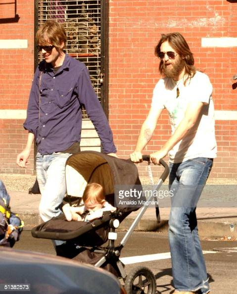Chris Robinson with son Ryder and an unidentified companion walk in the West Village while wife/mother Kate Hudson shops October 1 2004 in New York...