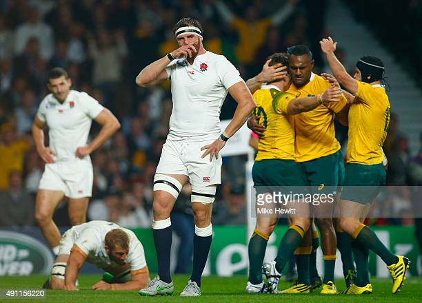 Chris Robshaw and Tom Wood of England react as Bernard Foley of Australia celebrates scoring their first try with team mates during the 2015 Rugby...