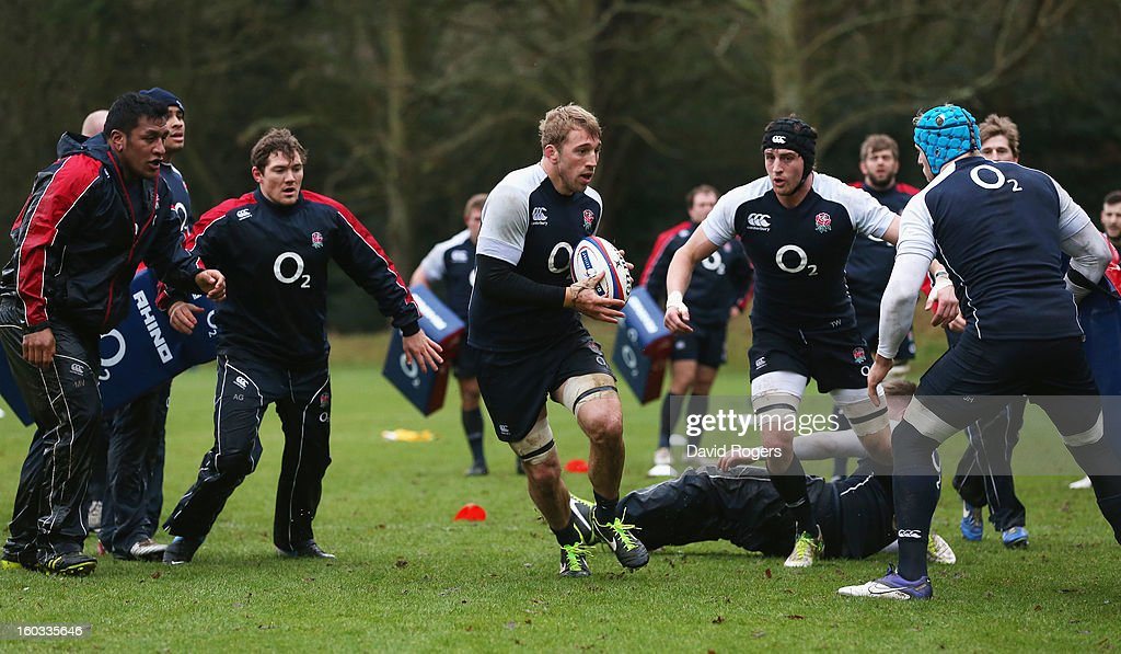 <a gi-track='captionPersonalityLinkClicked' href=/galleries/search?phrase=Chris+Robshaw&family=editorial&specificpeople=2375303 ng-click='$event.stopPropagation()'>Chris Robshaw</a> breaks with the ball during the England training session at Pennyhill Park on January 29, 2013 in Bagshot, England.